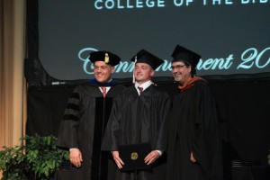 Steven Kennemore is recognized for receiving his Bachelor of Religious Studies degree at 2016 Commencement, pictured between President Fincher and Darryl Ammon.
